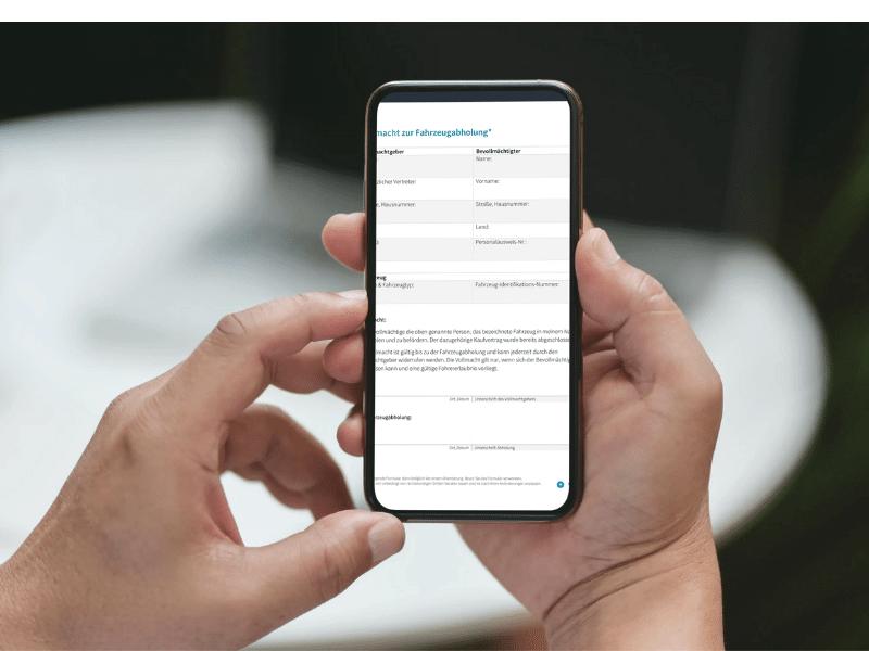 Vollmacht zur Fahrzeugabholung auf einem Smartphone geöffnet